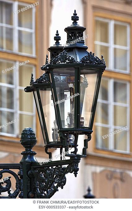 antique gas lamps at the old town square, prague, czech republic