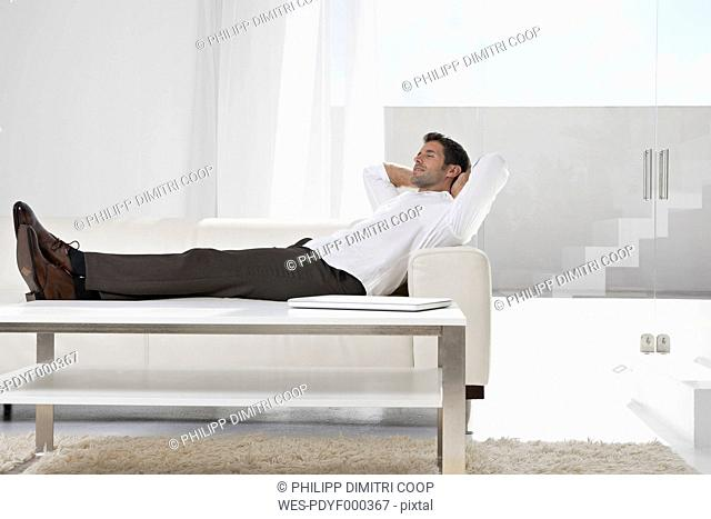 Spain, Businessman relaxing on couch
