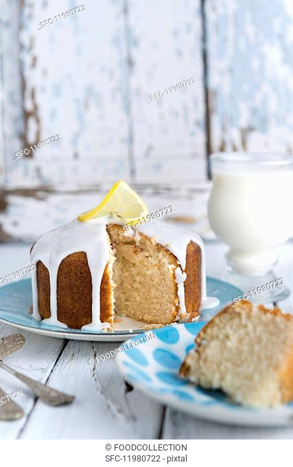 Vegan lemon drizzle cake with white icing