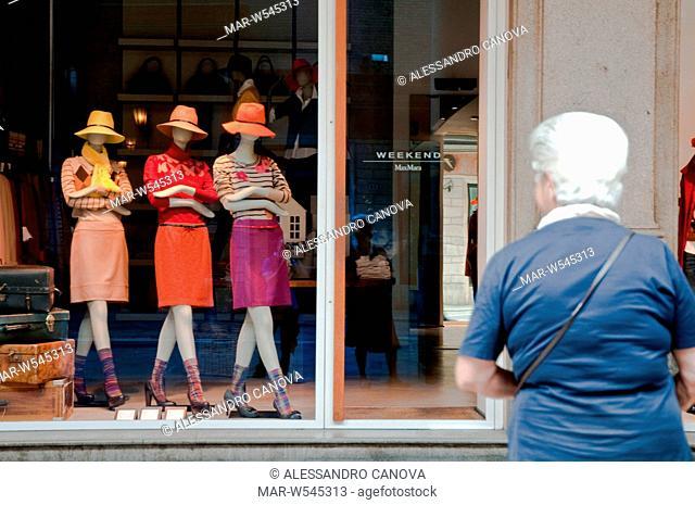 three mannequins in a shop window