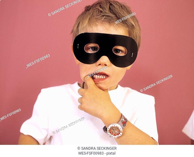 Portrait of little boy wearing black eye mask