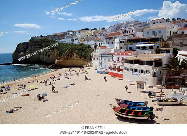 Portugal, Algarve, Carvoeiro, View of Town & Boats on The Beach