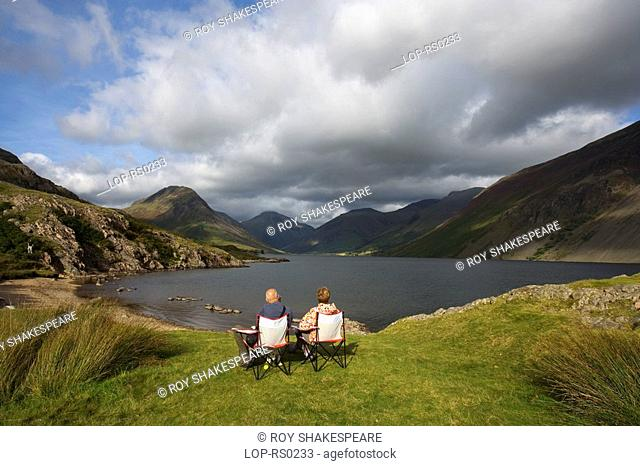 England, Cumbria, Wast Water, A couple enjoy the view over Wast Water. Wast Water is the deepest and coldest lake in the UK