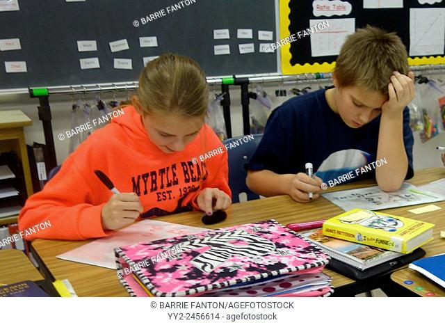 6th Grade Boy and Girl in Classroom, Wellsville, New York, United States