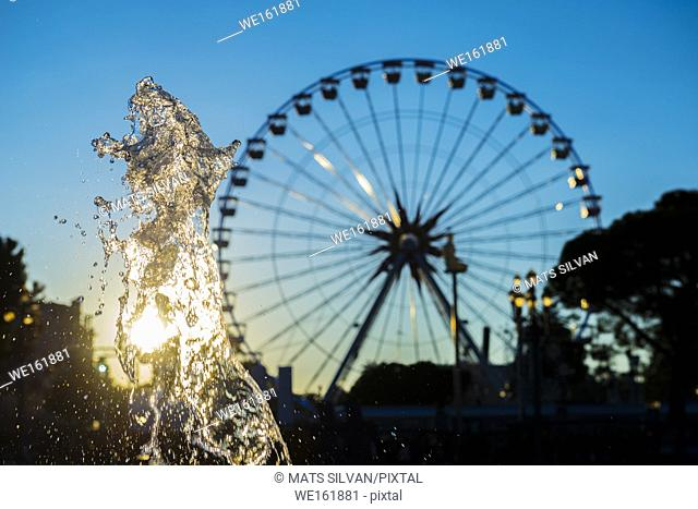 Ferris Wheel and Water Fountain with Sunlight in Nice, France