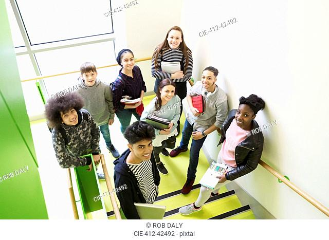 Portrait confident high school students on stair landing