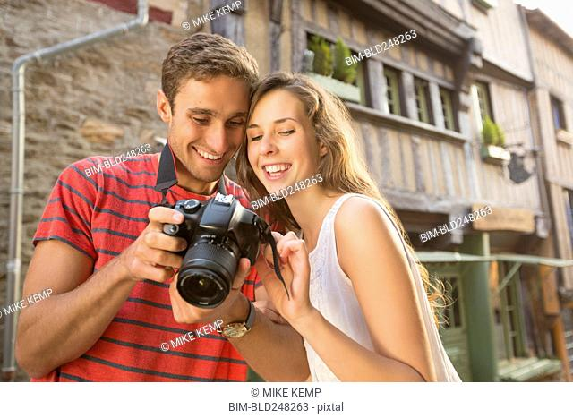 Caucasian couple examining the camera