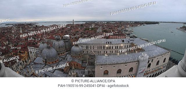 12 May 2019, Italy, Venedig: Wide angle: Eastern view from Campanile. From the Markusturm clouds lie over the city of Venice