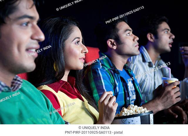 Friends enjoying movie in a cinema hall