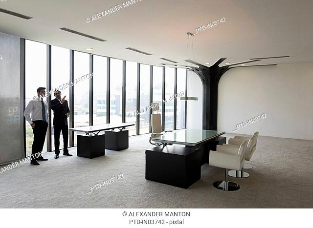 Two businessmen discussion office suite