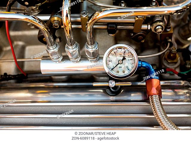 Engine compartment with pressure gauge