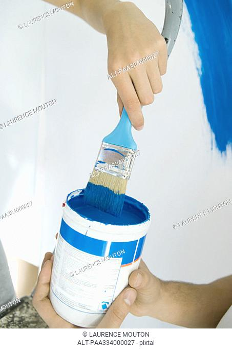 Couple with paint can and paint brush