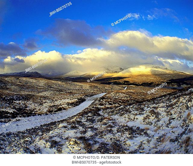 Hills of Blackmount and Rannoch Moor. Snowcaped path leads through the moore to the hills, United Kingdom, Scotland