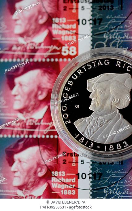 A ten-euro commemorative coin sits on a sheet of commemorative stamps, which were presented on the occasion of the 200th Birthday of Richard Wagner, in Bayreuth