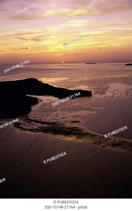 Aerial view of a beach at sunset