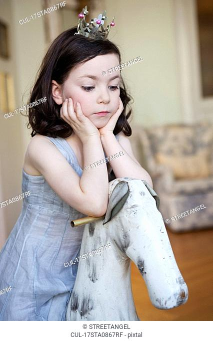 girl resting her head on her hands