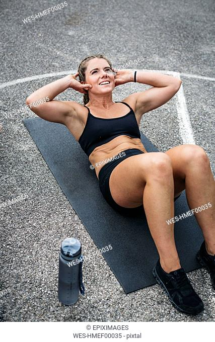 Woman during abdominal training, sit-up