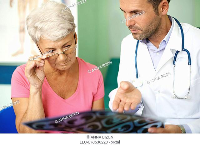 Doctor with his senior patient analyzing medical test. Debica, Poland