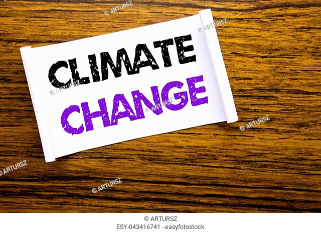 Word, writing Climate Change. Business concept for Global Planet Warming written on sticky note paper on wooden wood structure visible background