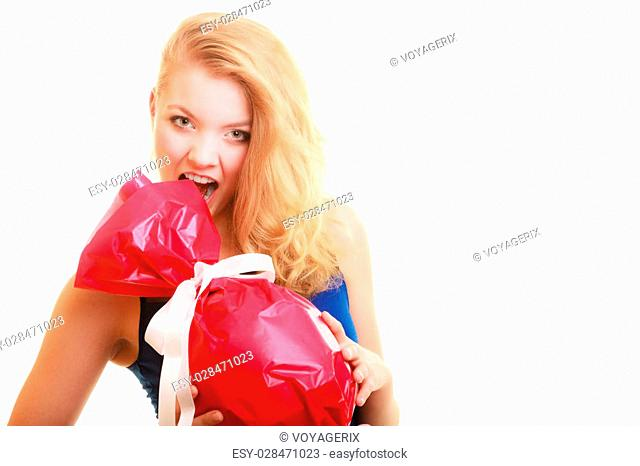 People celebrating holidays, love and happiness concept - smiling girl holding big red gift candy shaped isolated