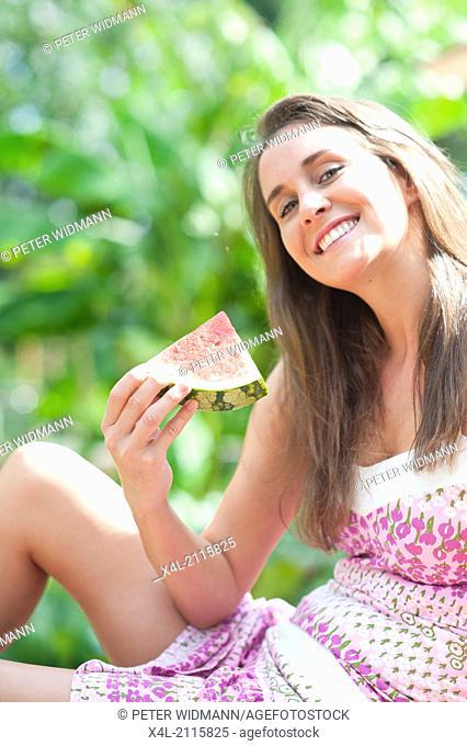 Young, beautiful woman in garden (model-released)