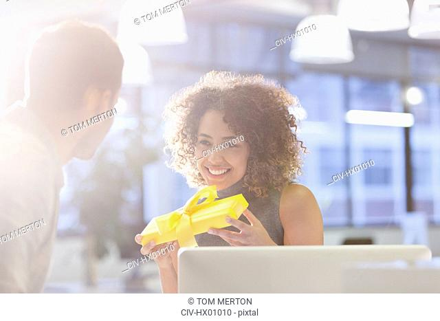 Businesswoman holding gift in office