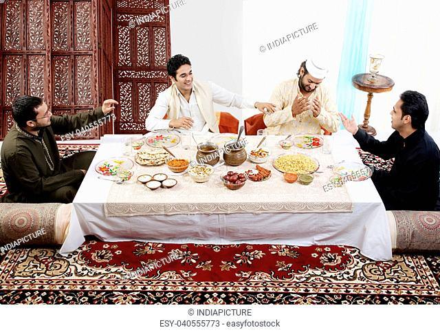 Muslim men enjoying themselves during Id