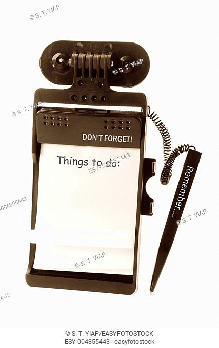 Note Pad with Ballpoint Pen on White Background