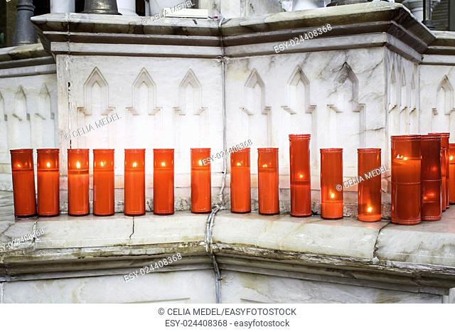 Red candles lit inside church, religion