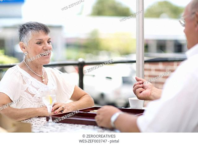 Senior couple playing backgammon