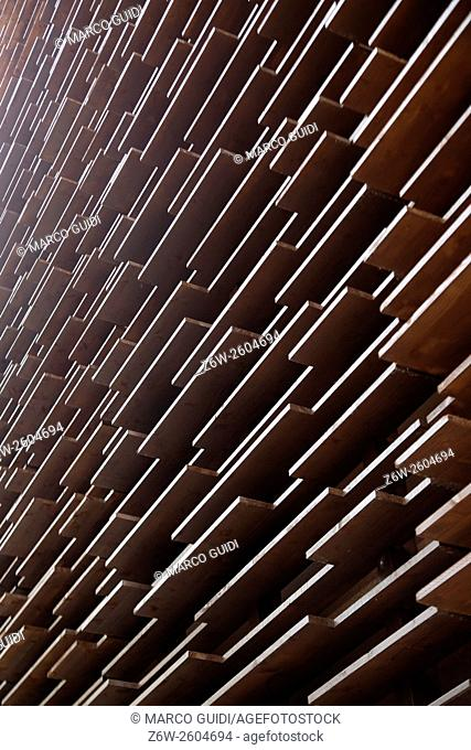 Perimeter wall of building built in wooden boards