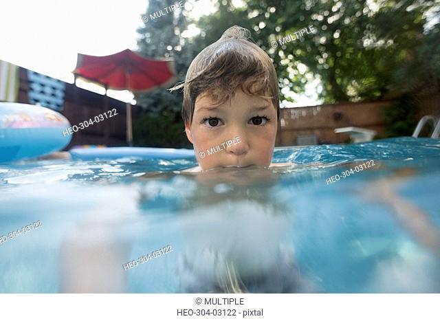 Portrait boy in swimming pool