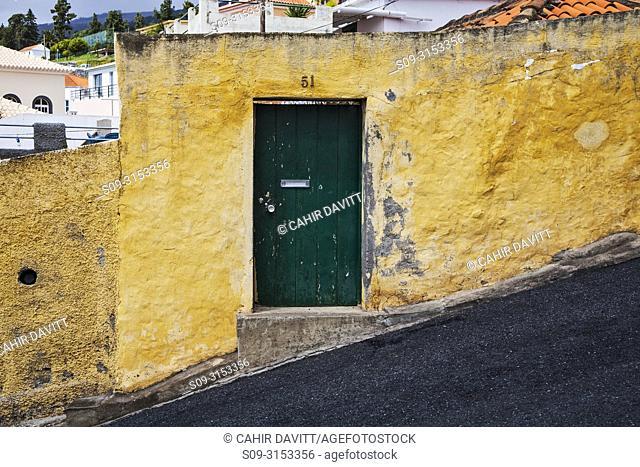Green entrance door to property located on Caminho do Meio, showing 18 degree steep street in the Terreiro da Luta suburb, Funchal, Ilha da Madeira, Portugal