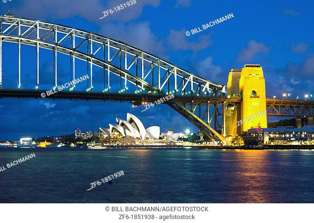 Twilight night exposure of color and great light of Famous Opera House and Harbour Bridge at skyline of Sydney Australia in New South Wales