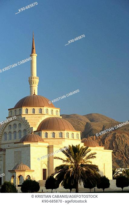 A mosque in the twilight with the Eastern Hajars mountain range in the background, Muscat, Oman, Arabia, Middle East, Asia