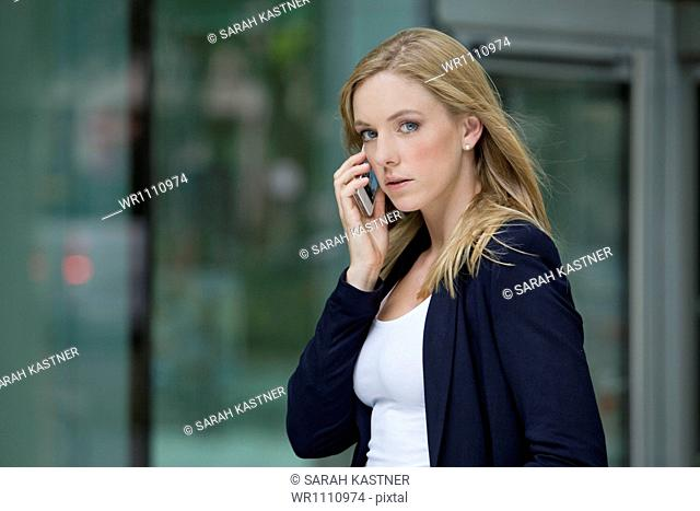 Young woman with smart phone