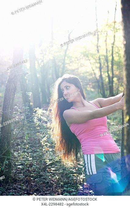 Young woman, sportive, in forest