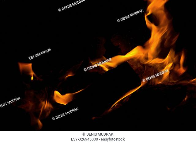 Fire flames on a black background. Blaze fire flame texture background. Close up of fire flames isolated on black background. Burn