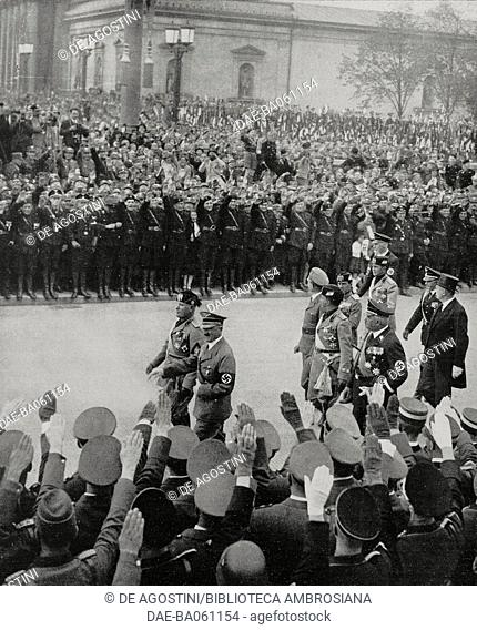 Benito Mussolini (1883-1945) and Adolf Hitler (1889-1945) review the formations of the Nazi Party, Munich, Germany; following: Italian and German Ministers of...