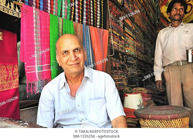 The man at the cloth shop in Paharganj, Delhi India