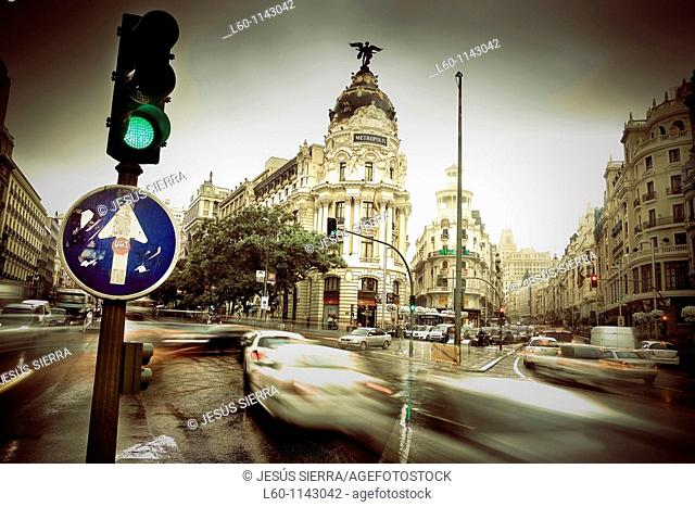 Metropolis building and Grassy building, romantic view  Gran Vía street, Madrid, Spain