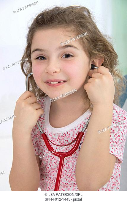 Girl wearing stethoscope