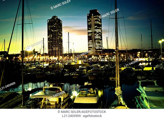 Port Olímpic at sunset. Hotel Arts and Mapfre Tower at skyline. View of harbour, boats and sea. Port of Barcelona, Barcelona, Catalonia, Spain
