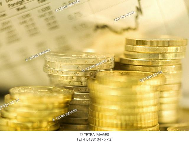 Stacks of euro coins and exchange rates