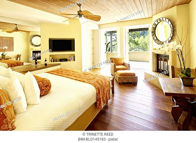 Empty hotel bed room with balcony overlooking wine country at a luxury resort in Napa Valley, California