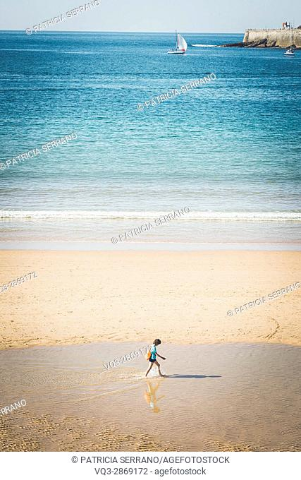 A boy on the seaside of La Concha, San Sebastian, Basque Country, Spain