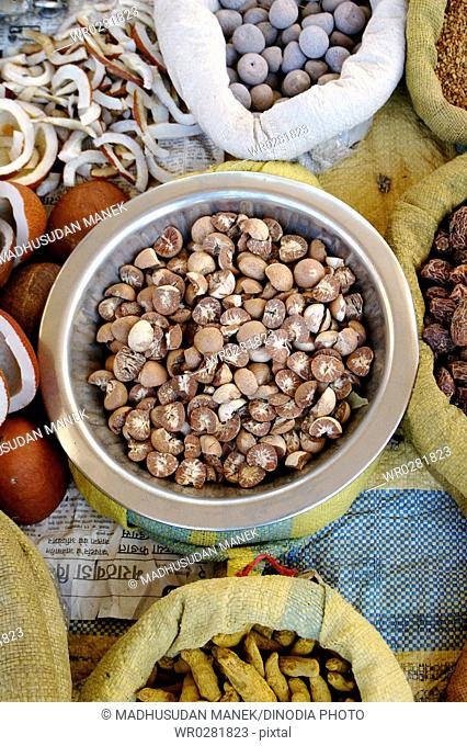 Indian spice betel nut kept in jute bag for sale in a market in India
