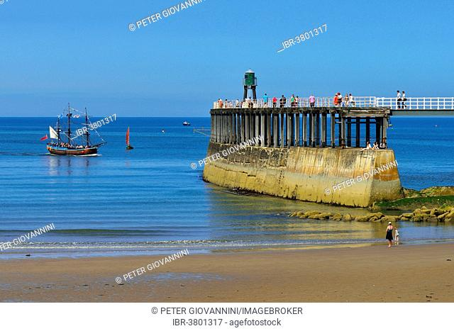 Historical excursion boat with three masts entering the harbour, Whitby, North Yorkshire, England, United Kingdom