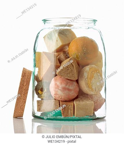 glass container filled with various flavors of homemade soap