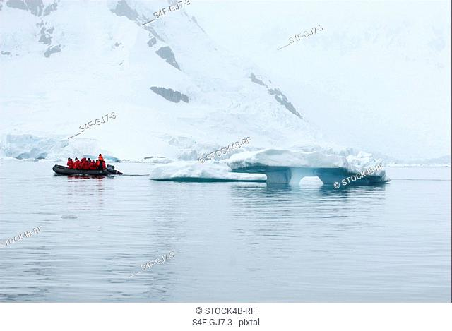 People in a dinghy in arctic landscape